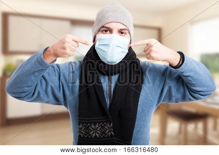 Man With Flu Wearing A Face Mask