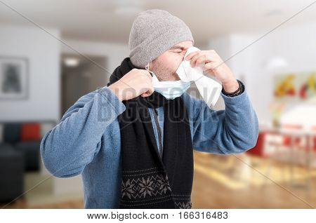 Man With Flu Blowing His Nose