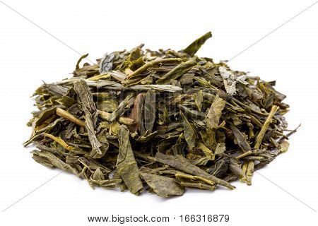 Heap of leaves of green japanese bancha tea closeup frontview isolated on white background.
