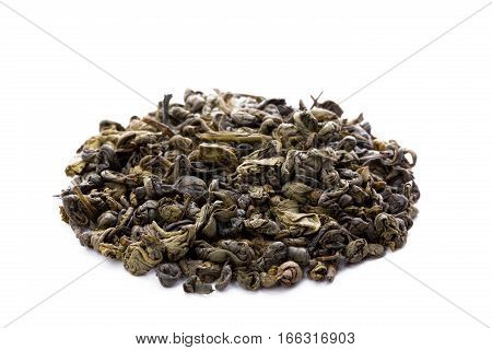 Heap of leaves of green chinese gunpowder tea closeup frontview isolated on white background.