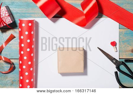 Valentine's Day greeting card over wooden background. Top view with copy space