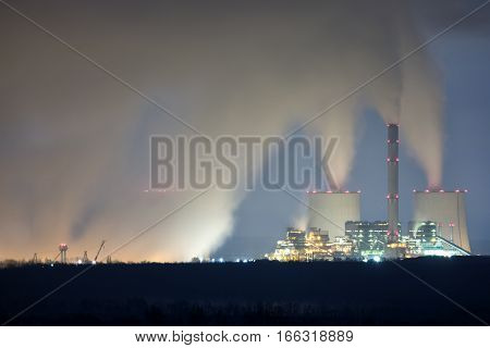 Huge and modern Powerplant producing heat at night