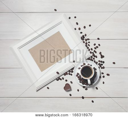 background with white wooden frame and coffee