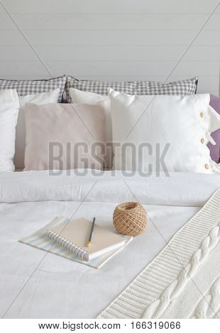 Notebook And Knitting Wool Setting On Bed In English Country Style Bedding Interior