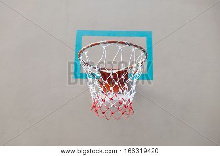 Close up red basketball hoop in the park