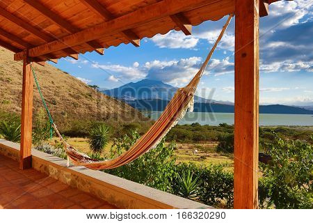 hammock on patio with volcano in the background in Ecuador