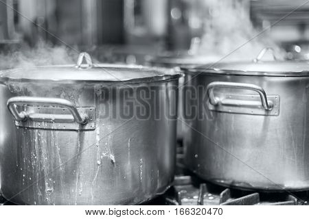 The big pot of boiling soup black and white stock photo