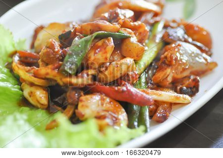 nakji bokeum or stir fried squid with green onion and Korean sauce Korean food