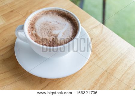 hot coffee mocha with foam milk in countryside cafe