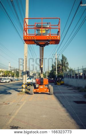 Lifting boom lift in construction site.,Construction equipment.