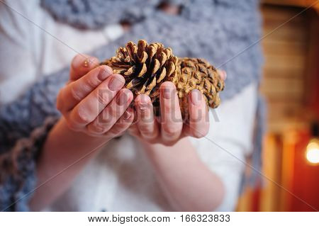 woman holding a pine cones in studio