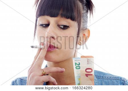 Woman smoking cigarette and looking money on white
