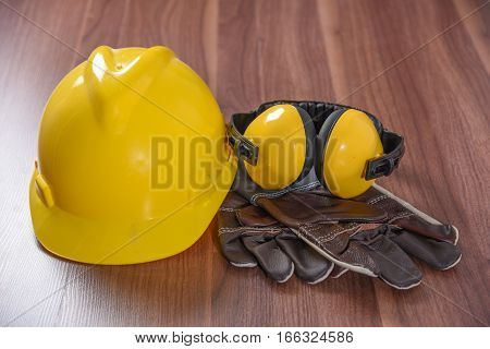 background, brown, builder, careful, carpentry, caution, cautious, close-up, clothes, clothing, construction, construction equipment, craft, danger, dangerous, deck, ear, engineer, equipment, eye, gear, glasses, glove, goggles, guard, hat, head, helmet, i