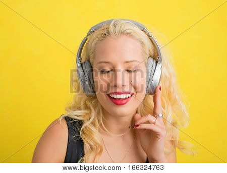 Woman with wireless headphones enjoying music with her eyes closed