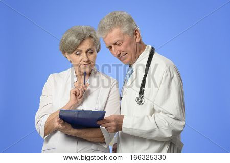 Portrait of a male and female doctors discussing diagnosis