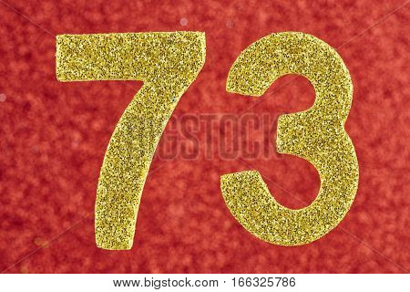 Number seventy-three yellow color over a red background. Anniversary. Horizontal