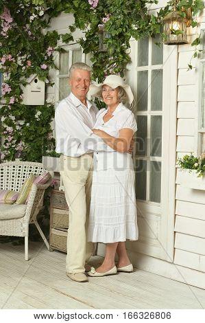 Portrait of beautiful elderly couple on veranda