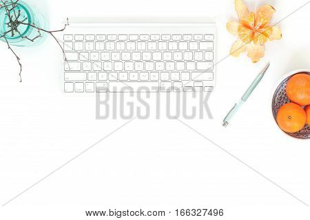 Minimal elegant desk composition flat lay with tangerine and turquoise vase