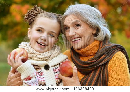 granny and granddaughter posing outdoors in autumn part