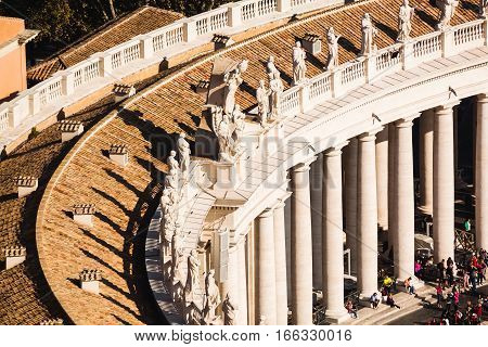 Close Up View Of Colonnade With Statues Of Saints Taken From Cupola Of Basilica. St. Peter's Square.