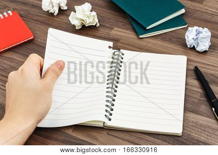 Hand Tearing Paper From Notebook