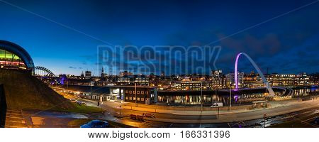 Newcastle Quayside Panorama at night, on the banks of the River Tyne with its famous bridges and Newcastle upon Tyne skyline beyond
