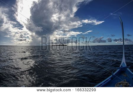A view of the vast Indian Ocean with a bow of a traditional Maldivian boat. poster