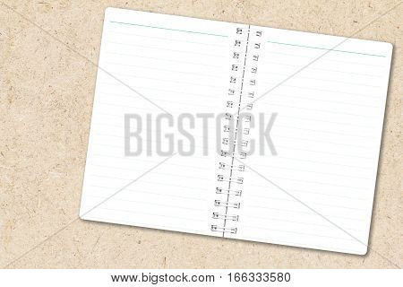 Open notebook paper with line on chipboard background for design with copy space for text or image.