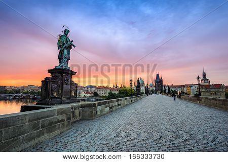 Sunrise at Charles Bridge and Prague city skyline, Prague, Czech Republic