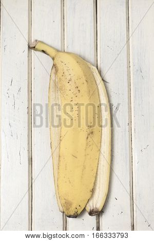 Bananas peel. Colored. Food art. Vintage striped surface