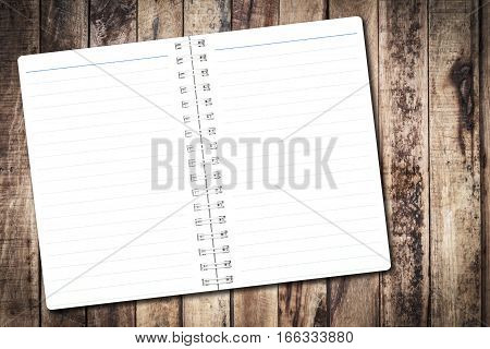Open notebook paper with line on wood background for design with copy space for text or image.