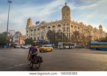 KOLKATA, INDIA -JANUARY 22, 2017: Important city road junction landmark at Chowringhee Dharamtala crossing Kolkata with colonial heritage buildings.