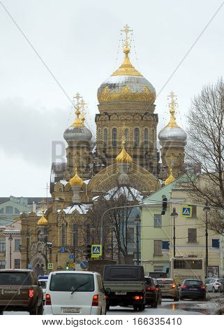 19.01.2017.Russia.Saint-Petersburg.The Church with gold domes against a background of moving cars.