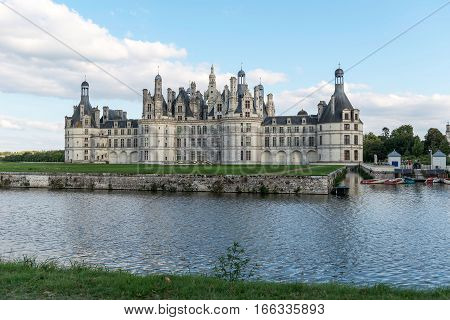 France. The ancient castle on the river bank