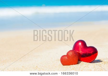 Sweet two heart on sand beach blue sky abstract background love summer