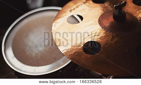 Closeup view on drum cymbal with holes.