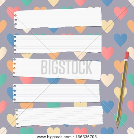 White ripped ruled notebook, copybook, note paper strips with pencil stuck on pattern created of colorful heart shapes.