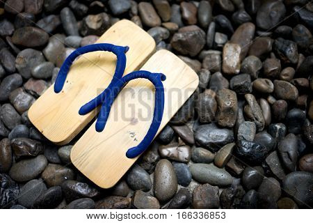 Wood sandals,japanese style shoes on the rock