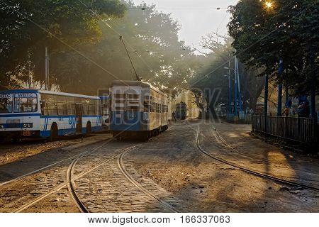 KOLKATA, INDIA -JANUARY 22, 2017: Heritage Kolkata tram standing on the track near a tramway depot at Esplanade, Kolkata on a foggy winter morning.
