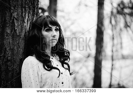 Young Sad Lonely Brunette Girl At Sleepwear. Black And White Photo.