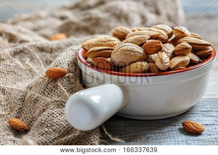 Crude Almonds In A Ceramic Bowl.