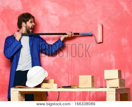 Shouting Man Holding Paint Roller