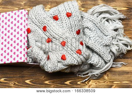 Red Valentines Heart, Present Box And Knitted Scarf On Wood