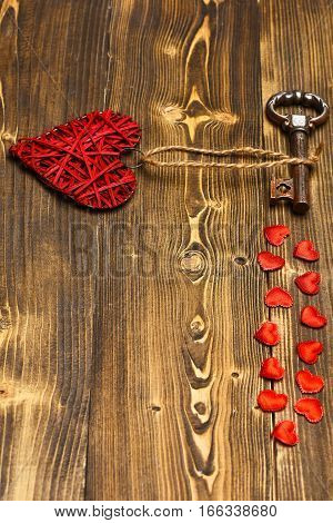 Red Heart And Metallic Key On Wood As Valentines Decoration