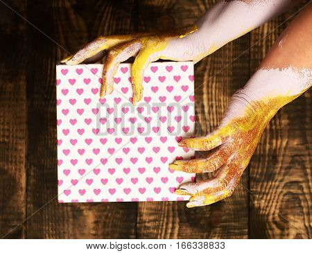Female Hands Holding Valentine Present