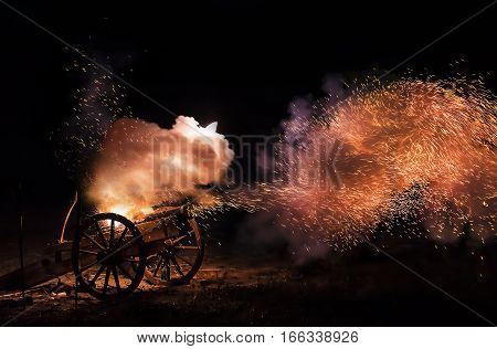 Cannon blast with burning sparkles flying out.