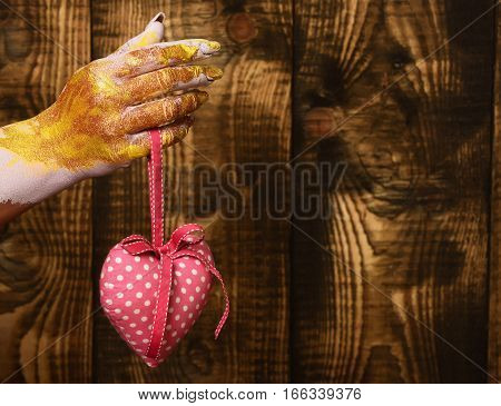 Female Hand Holding Valentine Heart