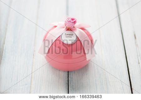Pink Gift Boxes In Round Shape On White Wooden Background. Valentine Background.