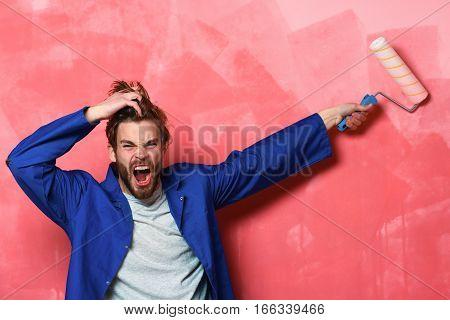 Shouting Builder Holding Paint Roller