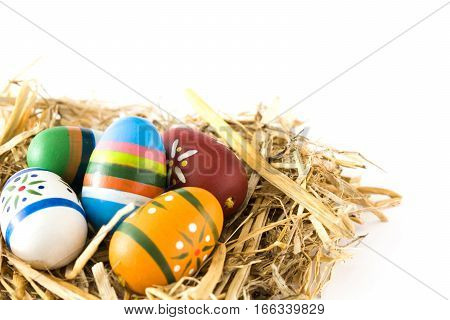 Easter eggs in a nest isolated on white background.Copyspace
